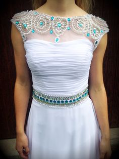 One of our new high neck gowns! Perfect for prom, homecoming, or any formal event! So elegant and stunning! Available at Bling It On Dress Rentals in Riverton, Utah. Contact us at 8018084656 or 8019797467 and find us on fb and insta!