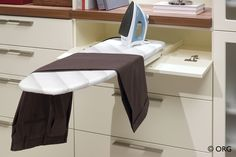 Pull-out ironing board for the closet, HomeORG.com