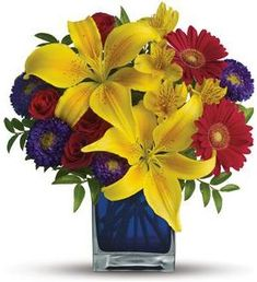 Flower bouquet or red roses yellow lilies and blue delphinium c blue caribbean bouquet the exciting bouquet includes yellow asiatic lilies red miniature gerberas purple matsumoto asters red spray roses and yellow mightylinksfo
