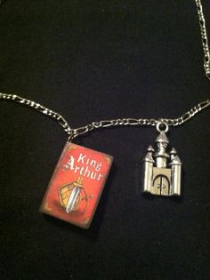 "King Arthur book necklace On 16"" silver coloured chain Castle charm $13"