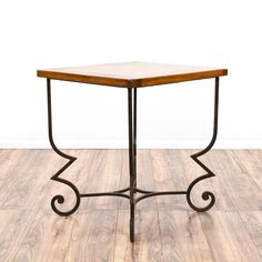 This end table is featured in a wrought iron with a brown patina finish. This contemporary side table has a raw wood table top, curved legs and a stretcher base. Perfect for the side of a sofa! #contemporary #tables #endtable #sandiegovintage #vintagefurniture