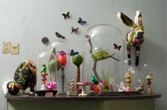 I like the mix of on the wall, on the table, under glass, . . . and lots of color