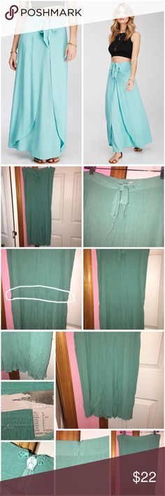 "✨FINAL PRICE✨ 🎉HP Tulip Front Maxi Skirt🎉 Never worn; just washed. Does have hanging marks and does have a cease (circled in first photo). Forever 21 contemporary skirt. Color is sea foam. It's more green than what the stock photos shows. Tulip front with a self-tie bow at waist. Crinkled woven fabric. Concealed back zipper. Unlined. 100% rayon. Length is approx 40"" and waist is approx 32"" laying flat. Stock photos from Forever 21. ❌NO TRADES❌ Forever 21 Skirts Maxi"