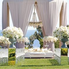Such luxe styling at this outdoor wedding reception with soft neutral palette #weddinginspo #weddingphoto #weddingvenue #weddingstyle #weddingstyling #outdoorwedding #draping #weddingreception #weddingceremony #whiteflowers #whiteroses #engaged #bride #bridetobe #bridal #bridalinspo #luxurywedding #luxewedding