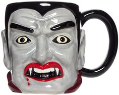 VAMPIRE COFFEE MUG - This vampire might want to drink your blood! But in the end you can enjoy your morning vice right out of his head. This ceramic mug is molded and painted to look like Dracula and is dishwasher and microwave safe.