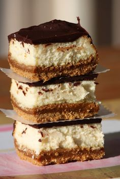 A tower of Dulce de Leche Cheesecake Bars.  Help me!  :)