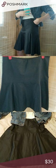 """FLIRTY FAUX LEATHER SKIRT, NWT Really cute faux leather skirt. Dress me up or down! Has a Side zipper. Waist measures 32"""". Drop flat front is 8 1/4"""" down to hip which measures 38"""" then flairs out with a semi-pleat. Pic. Shows shorter.  Waist to hem Length is 21"""".  NWT ( Bloomingdale's selling similar for $198.) S & I Designs  Skirts"""