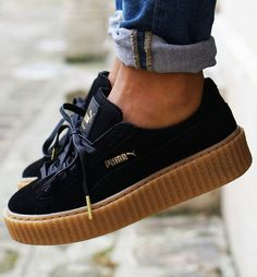 Black Rihanna for Puma Creeper Sneakers With a Platform Sole.