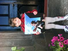 This gorgeous girl is Kaoimhie, aged 3 who recently came third (along with her Dad, Graham) in our Your Summer on Canvas competition.    Here she is with her prize!