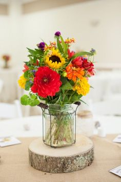 rustic red dahlias and yellow sunflowers wedding centerpiece / http://www.deerpearlflowers.com/40-dahlias-wedding-bouquets-and-cakes/
