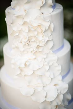 White Wedding Cake with some fantastic floral ruffles! The beauty is in the details. Candice Andrus Phototography. Boise Wedding Photography. www.candiceandrus.com