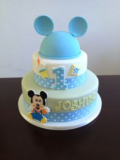 Mickey Mouse first birthday cake with marshmallow fondant.  Recipe at:  http://caketalkblogger.blogspot.com/2014/04/cake-coutures-marshmallow-fondant.html