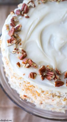 This incredibly moist homemade carrot cake is full of sweet spices, coconut, and carrots (both shredded carrots and carrot puree!). This carrot spice cake is completed with a homemade cream cheese frosting that is topped with toasted coconut and chopped pecans. This carrot cake is the best Thanksgiving dessert or Christmas dessert! #christmas #thanksgiving #cake #dessert