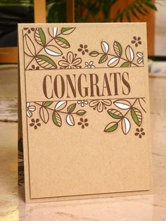 handmade congratulation card ... kraft ... almost one layer ... like the look of the brown, green and white inks ...
