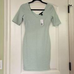 Never Worn NWT Forever 21 Short Mint Green Dress Mint green dress! So cute!! Never worn ! Brand new condition Forever 21 Dresses