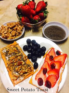 """Sweet Potato Toasts ...what??!   It's tasty and  delicious!  Fun part starts with a variety of toppings and heyyy breakfast's  ready in a snap 👌🏼 Sliced a couple of pieces (about a 1/4"""" thick) and placed in the toaster on HIGH for about 2-3 times until slightly brown .  Topped them with organic almond butter, walnuts, chia seeds  and my second choice, plain greek yoghurt, fresh strawberries 🍓 and dried cranberries ."""