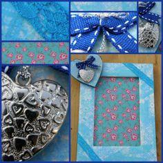 Leuk blauw fotolijstje met een houten hartje in de linkerbovenhoek en daarop een zilverkleurig hart met een blauw strikje. Het lijstje is bekleed d.m.v. deco patch techniek en afgewerkt met glans- en glitterspay en heeft 2 blauwe kantjes.