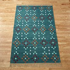 glint rug -5'x8' - $249 (less 15% is $211.65) - for entry rug - brings in a little red from the living room and compliments with teal!