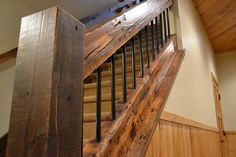 nice combination of rustic wood and metal/staircase