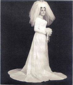 1965. I favor big, poofy veils, but this is a little bit too much even for me  : )