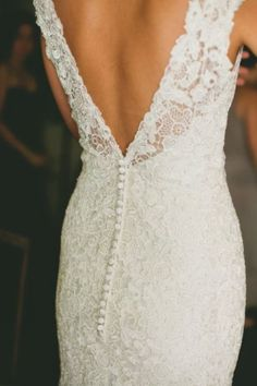 buttons down the back.. also love the lace / brittnie!
