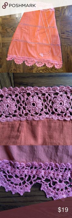 Pretty as a peach skirt with pink crochet elements Adorable peach skirt with crochet elements. Colors are best reflected in the first photo. Draw string waist allows for the perfect fit. Peach lining inside the skirt preserves modesty, while crocheted waist and hem reveal hints of skin. Smoke-free home. Skirts