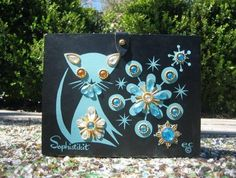 Black and Turquoise Sophistikit blue kitten, wood box purse by Enid Collis.