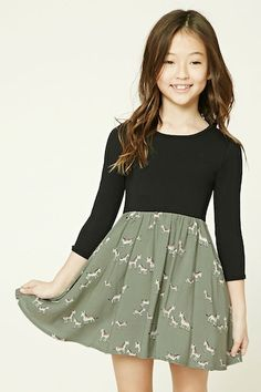 Forever 21 Girls - A combo dress featuring a woven skirt with an allover horse print, a knit bodice with 3/4 sleeves, round neckline, and a skater silhouette.
