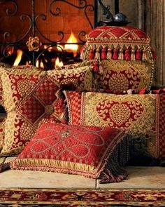 Pillows with a Moroccan feel - especially taken with extra-long fringe on narrow sides only (front pillow)