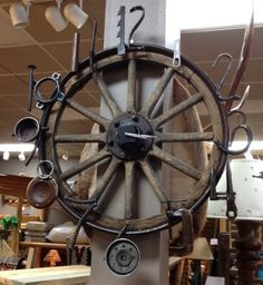Now this is a mans clock! Made from an old Model T spokes wheel and the numbers are fashioned from old tools. I guarantee you wont find one of your friends with the same clock!