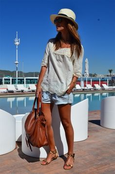 hat. denim shorts. white romantic shirt. leopard sandals. Perfect vacation outfit!