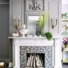 Modern Family I designed this classically inspired vista with a fresh point of view... #fireplace #fireplacewall #grey #gray #moldings #classic #architecture #architectural #architecturelovers #recycled #reclaimed #restoration #tile #glasstile #stylingtips #mirror #style #townhouse