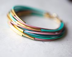 Pastel colors Leather Bracelet with 12 Golden tubes by pardes israel