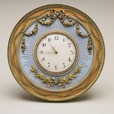 Fabergé Table Clock, workmaster Mikhail Perkhin, with blue enamel and elaborate acanthus and laurel leaf garlands