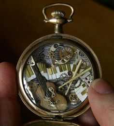 The world of music interpreted in a pocket watch. Love the idea of combining miniatures with jewelry!