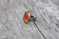 Adjustable antique bronze colored ring with real pink flower
