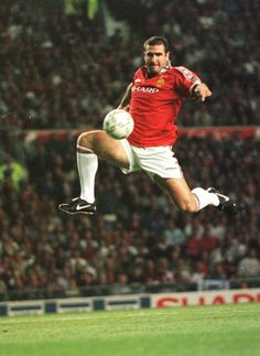Eric Cantona in testimonial action for United. Eric Cantona, France (AJ Auxerre, Martigues, Olympique Marseille, Bordeaux, Montpellier, Nimes Olympique, Leeds United, Manchester United, France)