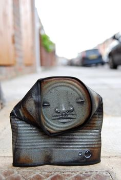 "Artist ""My Dog Sighs"" picks up discarded cans and bestows them with soulful, quirky faces."