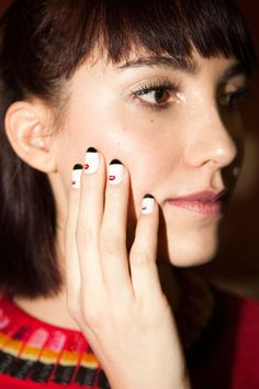 Referencing working girl films like The Apartment and How to Succeed in Business Without Really Trying, Miss Pop for Kiss created five nail art looks for Rachel Antonoff's fall collection. Our favorite of the bunch is this quirky red lip detail with a black French tip.