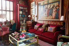charming red London library of designer Alidad