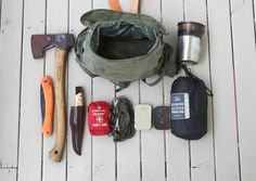 Bahco Folding Saw, GB Small Forest Axe, EnZo Trapper, first Aid Kit, ParraCord, Fire Kit, Char-cloth tin, Tarp/Hutchie, Stanley Cook set