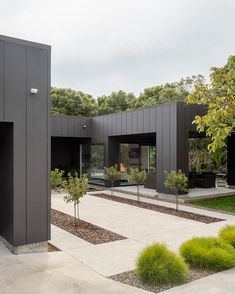 Architecture Garden Modern architecture meets a traditional garden courtyard in this stunning modern home clad in James Hardie's Stria Cladding Cladding Design, House Cladding, Exterior Cladding, House Siding, Facade Design, Facade House, Exterior Design, Cladding Ideas, Stucco Exterior
