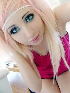 Beautiful light pink and blonde emo hair.