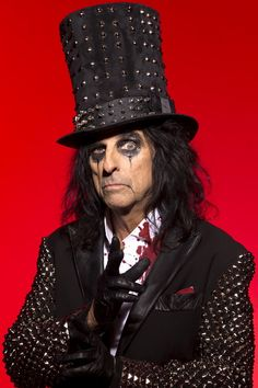 "Alice Cooper ~ Pintwist on school. Alice has a song called ""School's Out""."