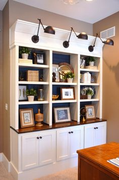 bookcases with navy blue grasscloth and ballard designs lighting