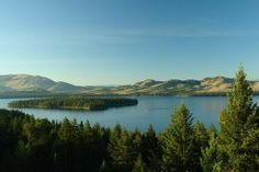 Flathead Lake, Montana  Flathead is the largest natural freshwater lake west of the Mississippi, with clean, crystalline waters cradled in t...
