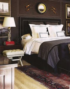 masculine. love the nailhead trim on walls and headboard. mary mcdonald.