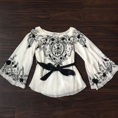 Floral Bell Sleeve Belted Blouse Perfect for wedding season, this beautiful top features black embroidery & beading. Papillon Tops Blouses