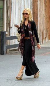 Who made Rachel Zoe's black sweater, scarf, black dress, platform shoes and purse that she wore in Malibu?