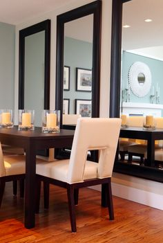 Idea from designer, Maria Killam: Large mirrors installed so that the reflection would give the illusion of dining chairs going all the way round the table. A great solution if you have a small space and need to work around it.